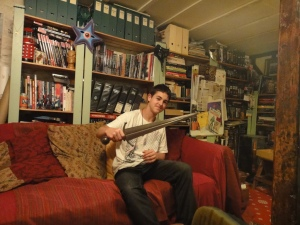 James with one of Dan's weapons in his underground Den