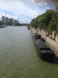 Black canal boat Seine, Paris