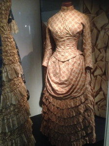 Victoria era dress showing rear view of draping V&A