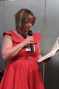Me reading a scene from Shatterwing (photo by Cat Sparks)