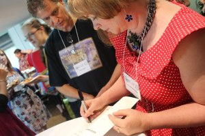 Me signing Shatterwing (photo by Cat Sparks)